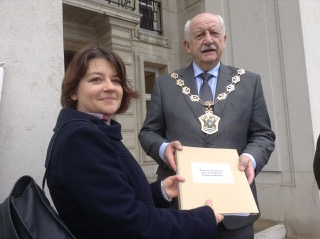 Abigail Woodman handing over petition to Waltham Forest Mayor